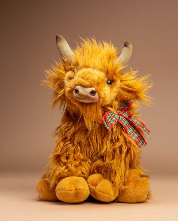 Highland Cow with tartan ribbon